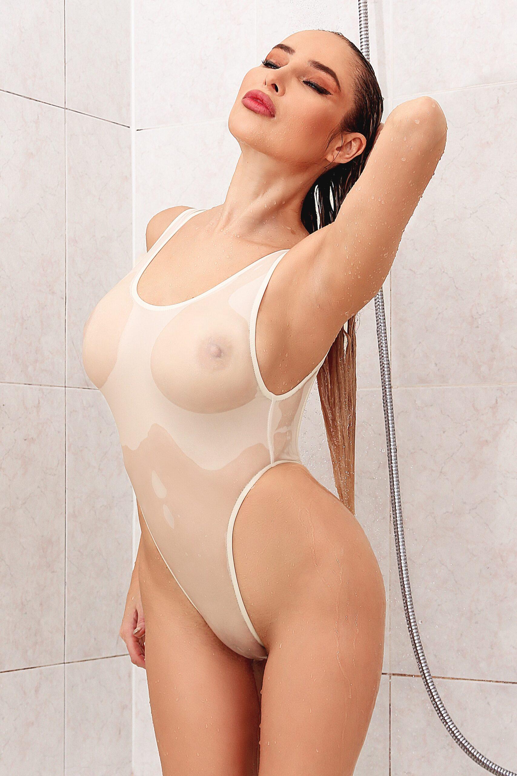 Sexy sheer when wet one piece swimsuit. Hot see through white rave bodysuit thong. High cut leg designer womens swimwear. Cheeky monokini.