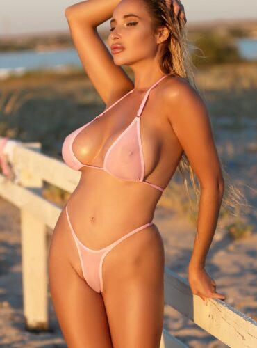 Sexy see through micro bikini thong set bottom and bra. Erotic cute sheer womens lingerie. Cheeky hot pink panties, high leg mini swimsuit.