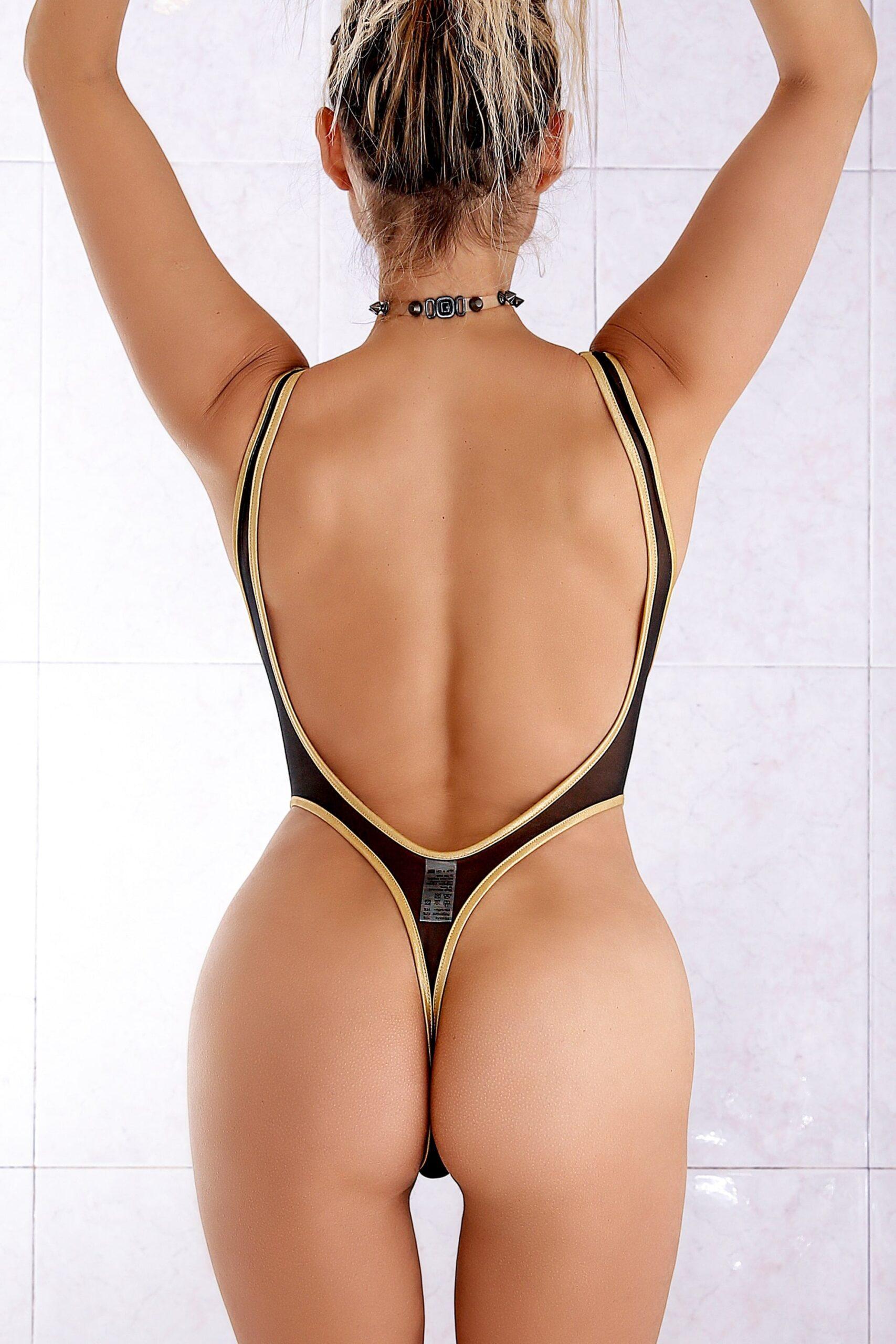 Sheer when wet mesh rave bodysuit thong. Sexy high cut leg one piece swimsuit monokini. See through designer black swimwear.