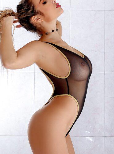 Sheer when wet mesh rave bodysuit thong. Sexy high cut leg one piece swimsuit monokini. See through designer swimwear. Black bathing suit.