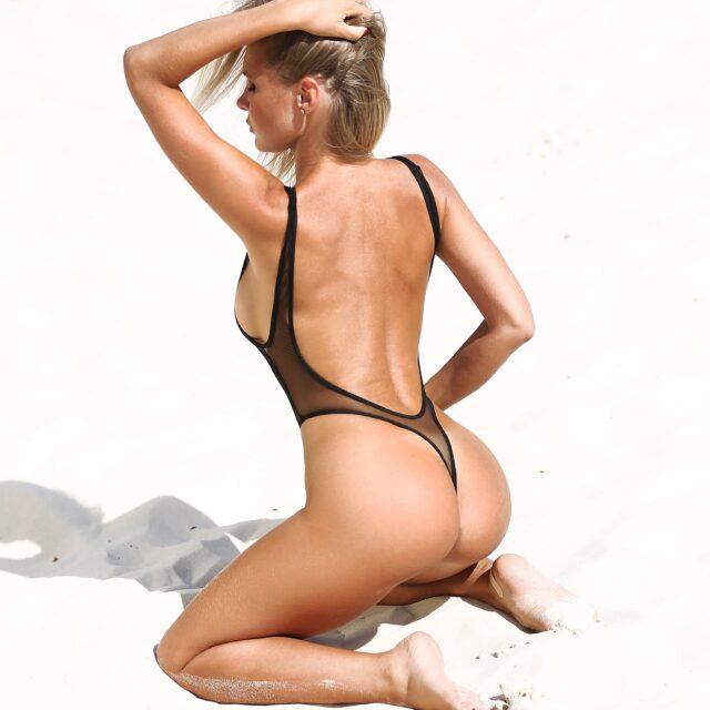 Sexy see through one piece thong swimsuit monokini. Sheer high cut leg black mesh rave bodysuit. Hot cheeky extreme designer women swimwear.